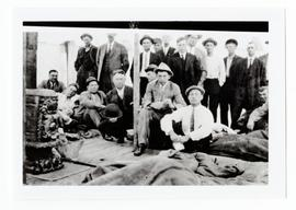 A group of men around a stove after a hard days drive