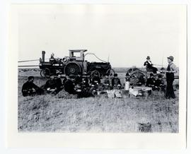 A harvesting crew eating lunch while in the field