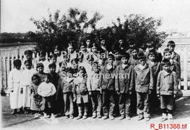A group photo of young native boys and girls