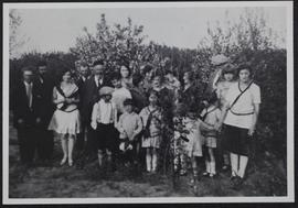 Group in orchard on Israel Hoffer's farm