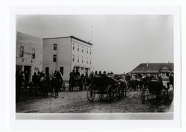 Horses, buggies, hotel, and railway station in Watrous