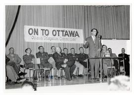 "The ""Ottawa delegation committee"" on the stage at a meeting held in Weyburn before the ..."