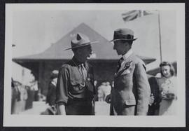 Governor-General talking to a Scout official on a station platform