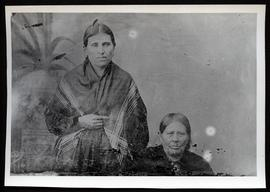 Two Indian women, bareheaded and with shawls