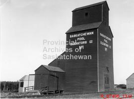 Miscellaneous views of grain elevators, farms, Saskatchewan Wheat Pool office, harvesting