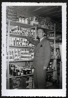 T.C. Douglas looking over stocks at Fort Black Co-op store
