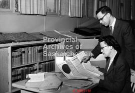 Saskatchewan Archives Board office, Saskatoon.  D.H. Bocking and Evelyn Eager in Reading Room loo...