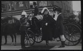 George William Brown stepping from carriage during Regina visit, attended by top-hatted and white...