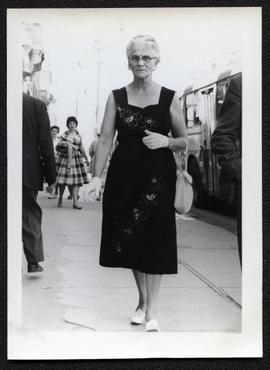 Mrs. Bessie H. Myers walking down street