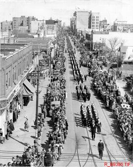 Military parade on 11th Ave., looking east at downtown