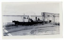 Unloading Welsh coal from a ship in Churchill, Manitoba harbour