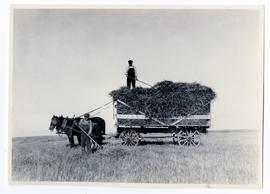 A rack full of straw, men working