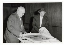 J.H. Wesson being presented with a framed picture