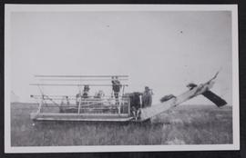 Cutting wheat with header in Allan district