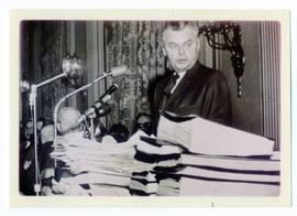 John Diefenbaker looking at petitions