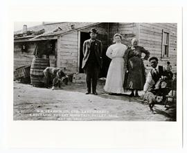 Paul Schwandt of Strasbourg, Mr. and Mrs. Lorenz of Quinton and another woman outside a frame house