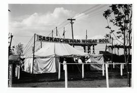 A Saskatchewan Wheat Pool tent at an exhibition, possibly Regina