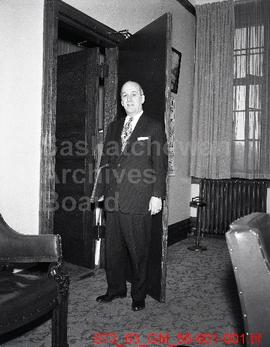 [Unidentified man dressed in a suit]
