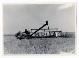 Holt swather pulled by a tractor