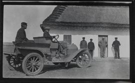 Early roadster with box over rear wheels; Ukrainian house