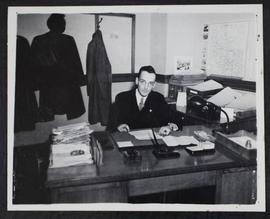 S. Dornan at his desk