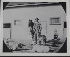 """76"" Ranch - unidentified man with dogs"