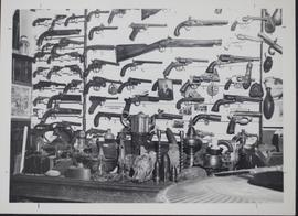 Museum at Riverhurst showing a display of guns and shells