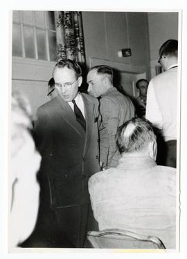 T. C. Douglas talking to farmers at a meeting