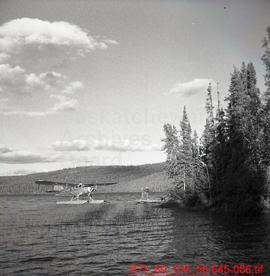 Airplane Landing at Prospectors Camp on Cinch Lake in Beaverlodge Field