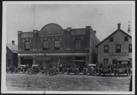 "Automobiles in front of J.B. Stauffer's shop in Saskatoon with his ""windwagon"" (propell..."