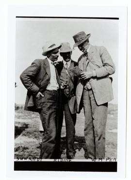 William Pearson, Mr. Schwandt and Mr. Riding looking over a map