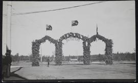 "Prince Albert - arches on bank of river with banner ""P.A. to the Bay"""
