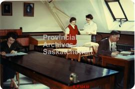 Evelyn Eager with typist Eugenia Desnoyers and two researchers, A.N. Reid seated right.  Saskatch...