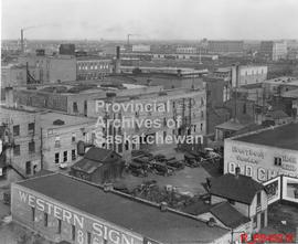 Rooftop view of some downtown buildings, looking north west at the railway yard from Rose St. alley
