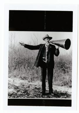 A man (possibly William Pearson) using a megaphone.