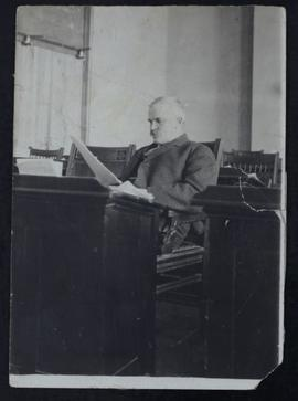 Archibald Peter McNab seated at desk