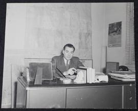 Charles Andrew LaVerne Hogg in his office