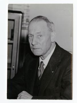 Head and shoulders of George W. Robertson, secretary, Saskatchewan Wheat Pool