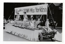 Contestants for the title Miss Yorkton on parade float